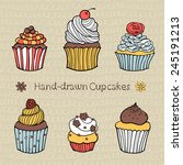 set of hand drawn cupcakes with