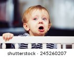 little boy is crying in the bed | Shutterstock . vector #245260207