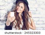 hipster girl using a phone | Shutterstock . vector #245323303
