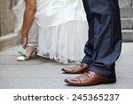 bride and groom's feet on... | Shutterstock . vector #245365237