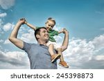 son seating on the father under ... | Shutterstock . vector #245398873
