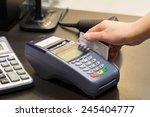 hand swiping credit card in... | Shutterstock . vector #245404777