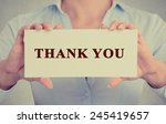 Small photo of Closeup retro vintage style image business woman, female, girl, person hands holding white rectangle sign or card with message thank you isolated on gray office wall background.