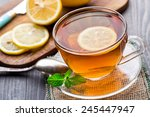 cup of tea with mint and lemon | Shutterstock . vector #245447947
