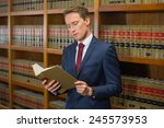 handsome lawyer in the law... | Shutterstock . vector #245573953