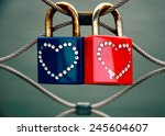 Two Grungy Love Padlocks With...