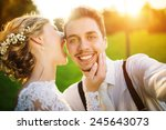 young wedding couple taking a... | Shutterstock . vector #245643073