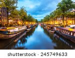 Stock photo canals of amsterdam at night amsterdam is the capital and most populous city of the netherlands 245749633