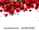 Stock photo red roses and heart shape ornaments on white background 245842987