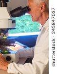 senior scientist looking... | Shutterstock . vector #245847037