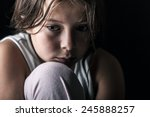 powerful shot of sad child | Shutterstock . vector #245888257