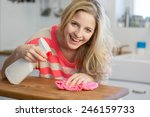 young woman cleaning kitchen... | Shutterstock . vector #246159733
