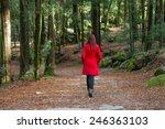 Young Woman Walking Away Alone...