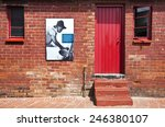Small photo of Soweto, South Africa - March 15 2010: The entrance door of the Mandela home now transformed into a museum