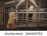 Small photo of Sad girl waving, she says goodbye with a teddy bear and it's very sad.