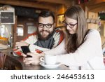 friends in a cafe using phone...   Shutterstock . vector #246453613