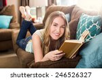 young woman reading on the... | Shutterstock . vector #246526327
