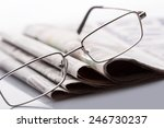 Glasses On The Newspapers