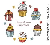 set of hand drawn cupcakes on