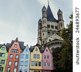 Small photo of Great St. Martin Churchand and colorful houses of Cologne. Cologne, North Rhine-Westphalia, Germany