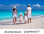 back view of young family with... | Shutterstock . vector #246994477