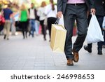 suit with shopping bags on... | Shutterstock . vector #246998653