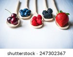 berries on wooden background | Shutterstock . vector #247302367
