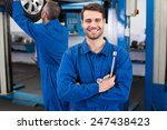 mechanic smiling at the camera... | Shutterstock . vector #247438423