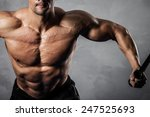 brutal athletic man pumping up... | Shutterstock . vector #247525693