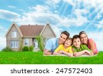 happy family near new home.... | Shutterstock . vector #247572403