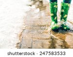 gumboots in a puddle in the... | Shutterstock . vector #247583533