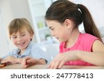 kids playing with toy cars at... | Shutterstock . vector #247778413