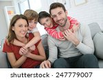 cheerful family at home sitting ... | Shutterstock . vector #247779007