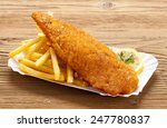 fried fish and chips on a paper ... | Shutterstock . vector #247780837