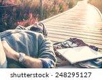 Urban Man Lying On A Catwalk I...