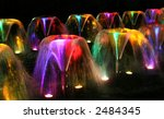 Bright and colorful fountains at night - stock photo