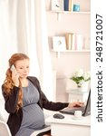pregnant business lady at work. ...   Shutterstock . vector #248721007