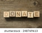 donate text on a wooden... | Shutterstock . vector #248769613