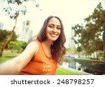 girl sitting in the park of... | Shutterstock . vector #248798257