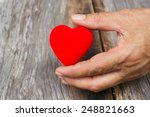 old woman's hand holding  a red ... | Shutterstock . vector #248821663