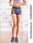 sporty woman and measure around ... | Shutterstock . vector #248840887