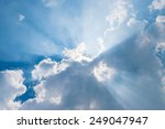 Clouds In Blue Sky With Sun Rays