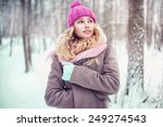 pretty blonde girl walking in a ... | Shutterstock . vector #249274543
