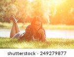 relaxing woman on grass | Shutterstock . vector #249279877