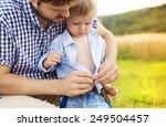 cute little boy getting dressed ... | Shutterstock . vector #249504457