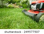 red lawn mower cutting grass.... | Shutterstock . vector #249577507