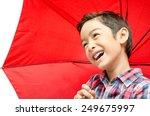 Little Boy Taking Red Umbrella...