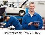 smiling mechanic using a tablet ... | Shutterstock . vector #249721897