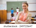 pretty teacher smiling at... | Shutterstock . vector #249725647