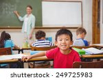 cute pupil smiling at camera in ... | Shutterstock . vector #249725983
